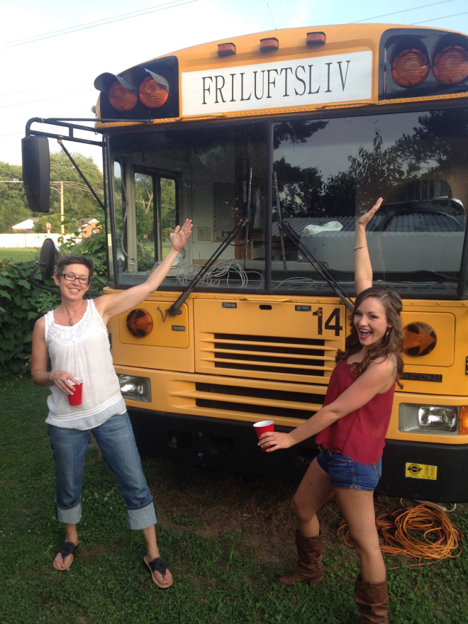 Me and Taylor at the buswarming party... Steve's neighbors made the Friluftsliv sign - I love it!!